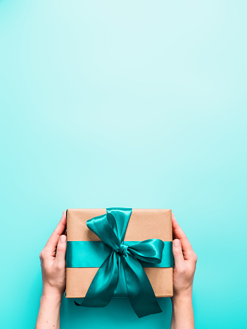 istock Female hands hold gift box, copy space top 1163530309
