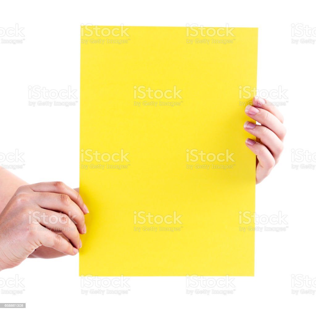 female hands hold up blank yellow sheet of paper stock photo more