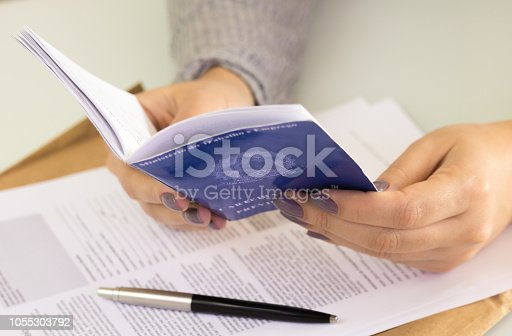 istock Female hands holding a A portfolio of Brazilian workers (Translation