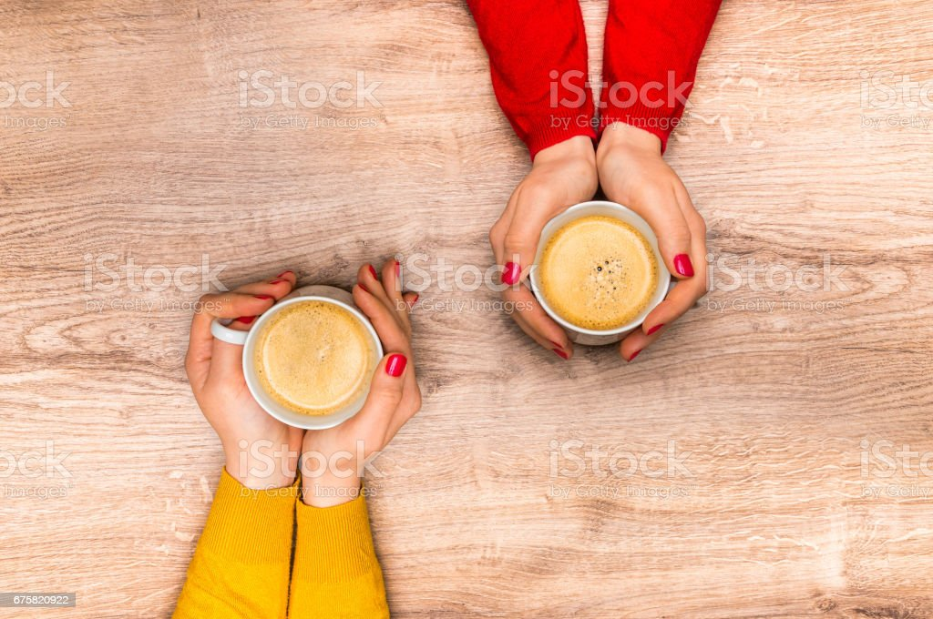 Female hands holding a cup of hot coffee stock photo