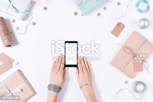 istock Female hands holding a mobile phone 870091080