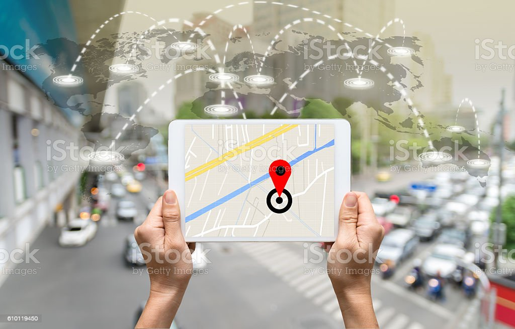 female hands holding a tablet showing part of navigator map stock photo