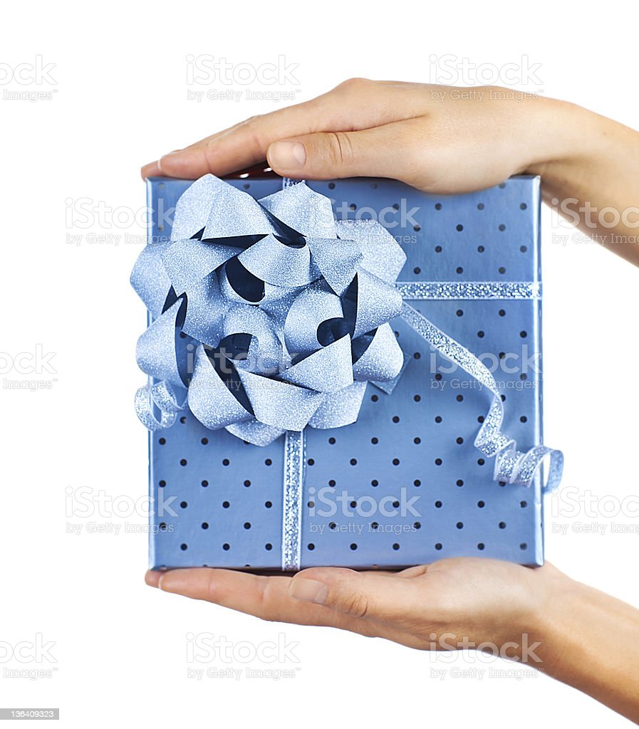 Female hands holding blue gift box royalty-free stock photo