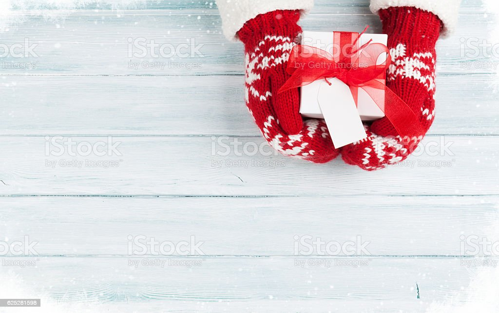 Female hands holding christmas gift stock photo