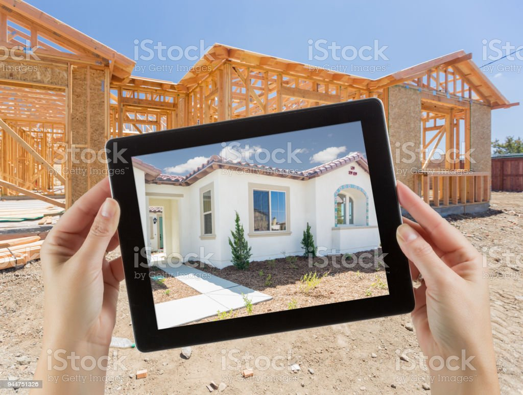 Female Hands Holding Computer Tablet with Finished House on Screen,...