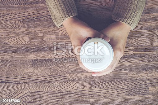 istock Female hands holding cups of coffee 901187090