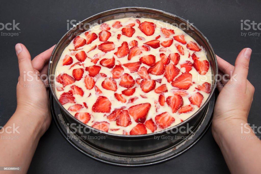 Female Hands Holding Delicious Fruit Strawberry Cheesecake over Black Background. Healthy Dessert. - Zbiór zdjęć royalty-free (Ciasto)