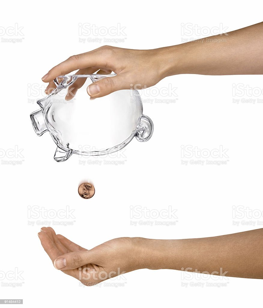 Female Hands Holding Empty Piggy Bank Upside-down Isolated royalty-free stock photo