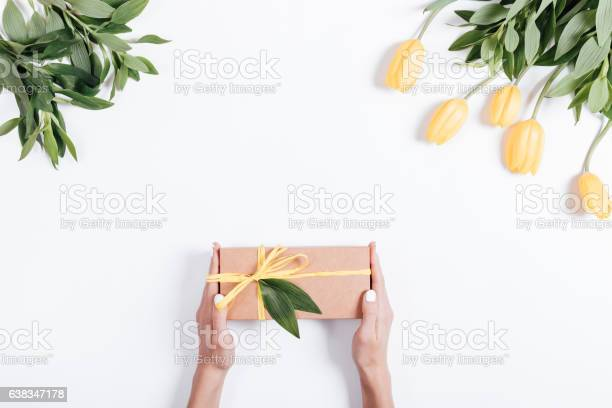 Female hands holding gift box with yellow ribbon picture id638347178?b=1&k=6&m=638347178&s=612x612&h=hg65978 cq3ukxbq7a5njuvlfwjv4chunow rew0lle=