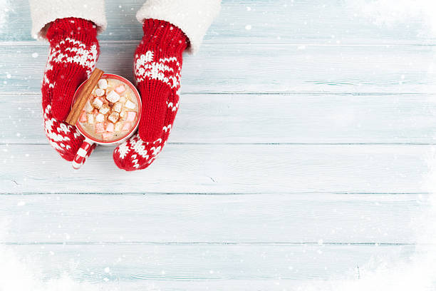 female hands holding hot chocolate - hot chocolate stock photos and pictures