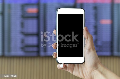 istock Female hands holding mobile phone 1172774696