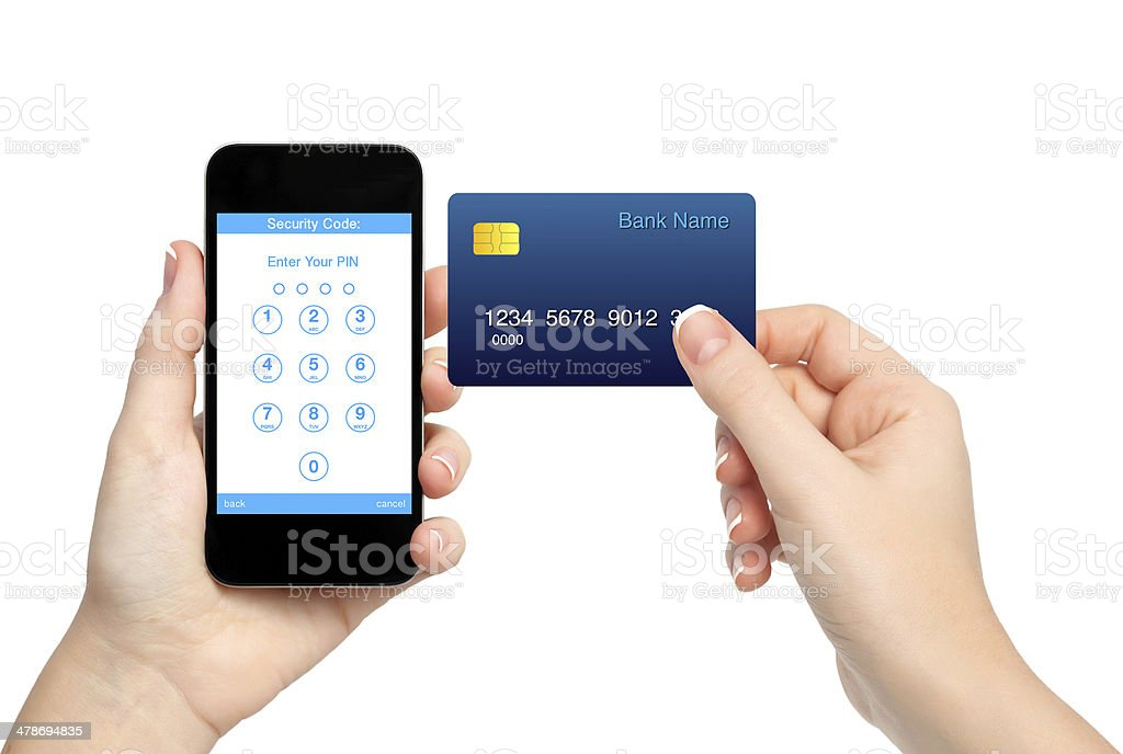 female hands holding phone and credit card stock photo