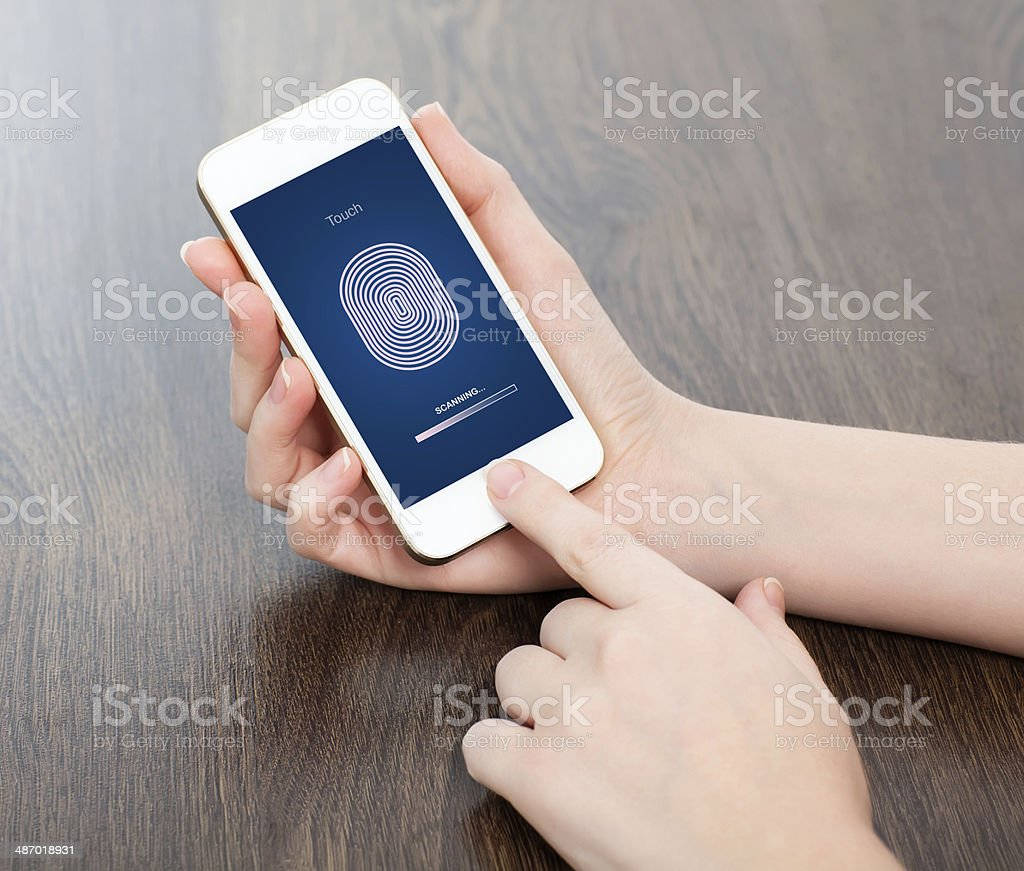 female hands holding phone and entering PIN code of finger stock photo