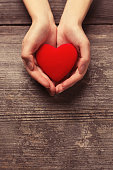 istock Female hands holding red heart 1096150282