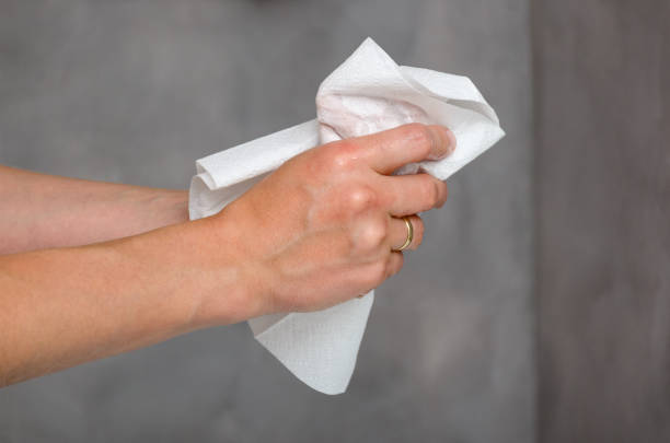 Female hands holding white towel stock photo