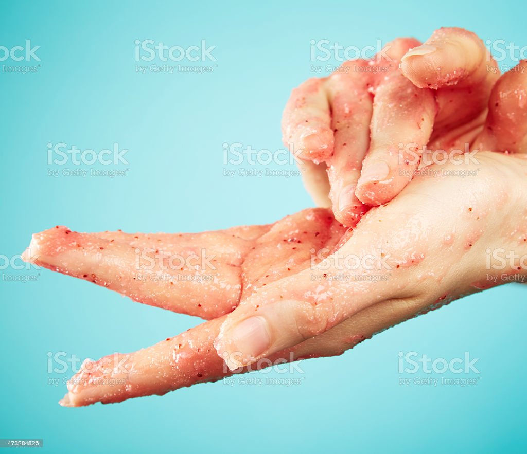Female hands in body scrub stock photo