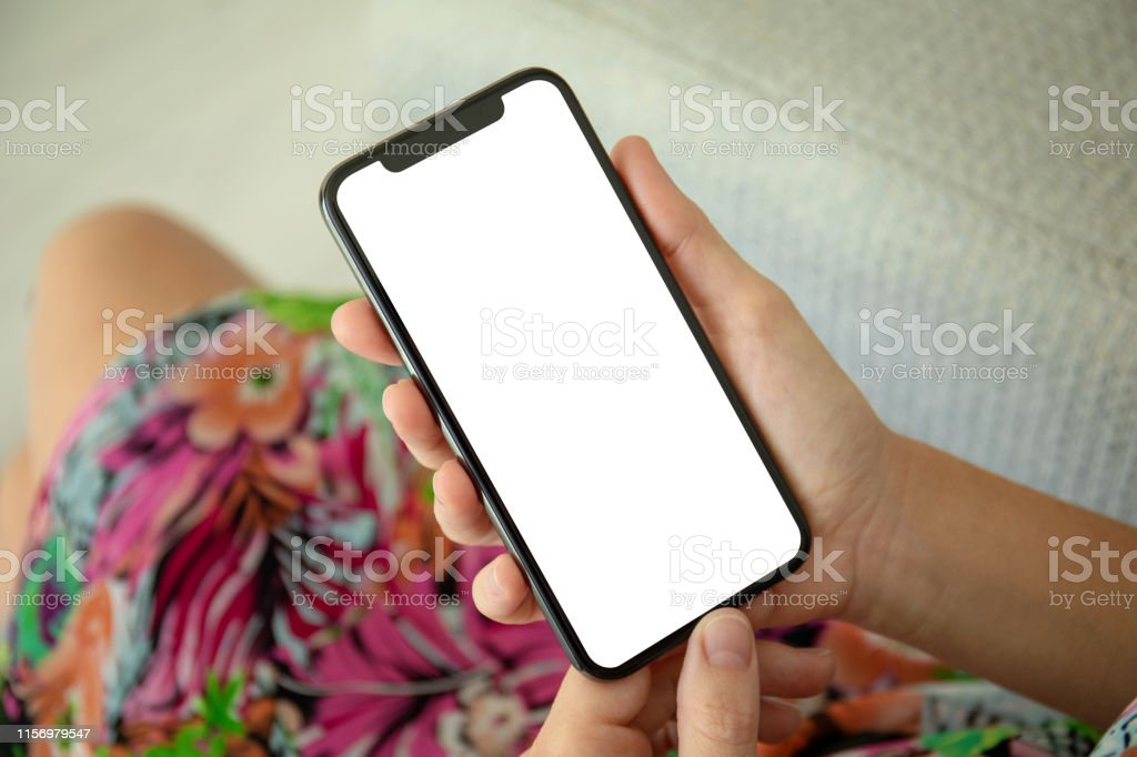 female hands in colored dress holding phone with isolated screen