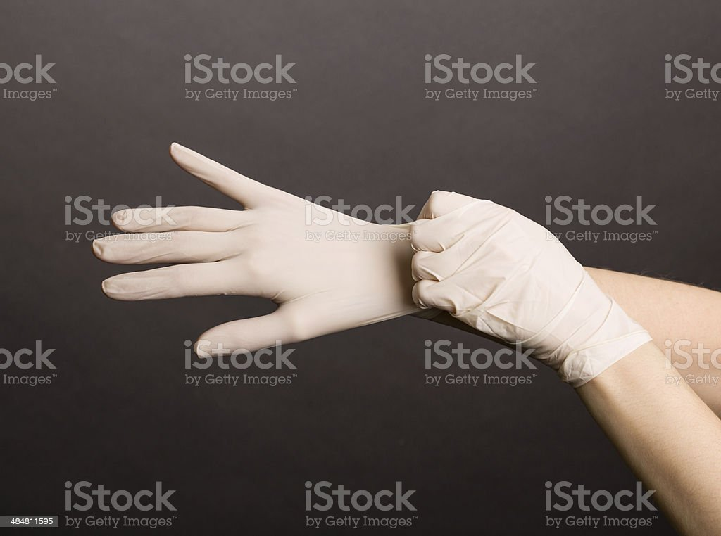 Female hands in latex gloves stock photo