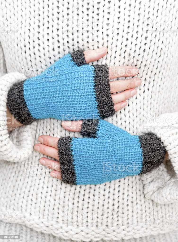 Female hands in mittens stock photo