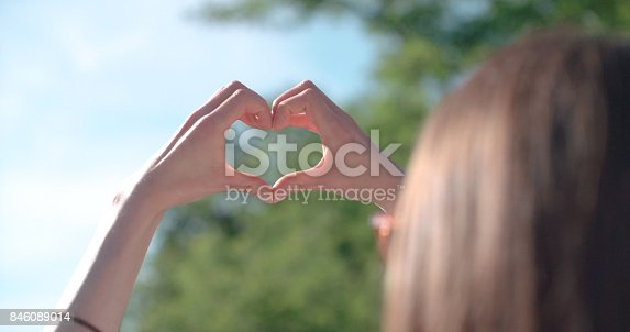 Rear view of young girl showing heart.