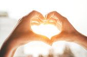 istock Female hands in the form of heart. 1216326756