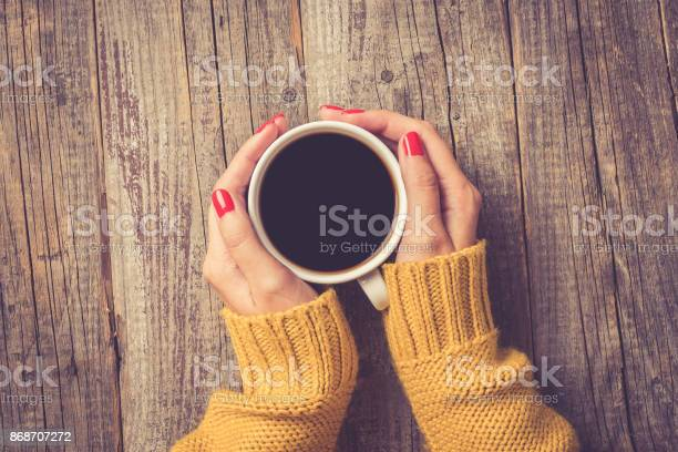 Female hands in warm sweater holding cup of coffee picture id868707272?b=1&k=6&m=868707272&s=612x612&h=q jluwonrar2vnljcogubvtq4szhsjaaf54f4mobep4=