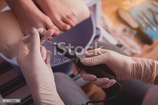 938027870 istock photo Female hands keeping appliance for visitor feet 938027790
