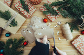 istock Female hands make a advent calendar on a wooden table. 1281998438