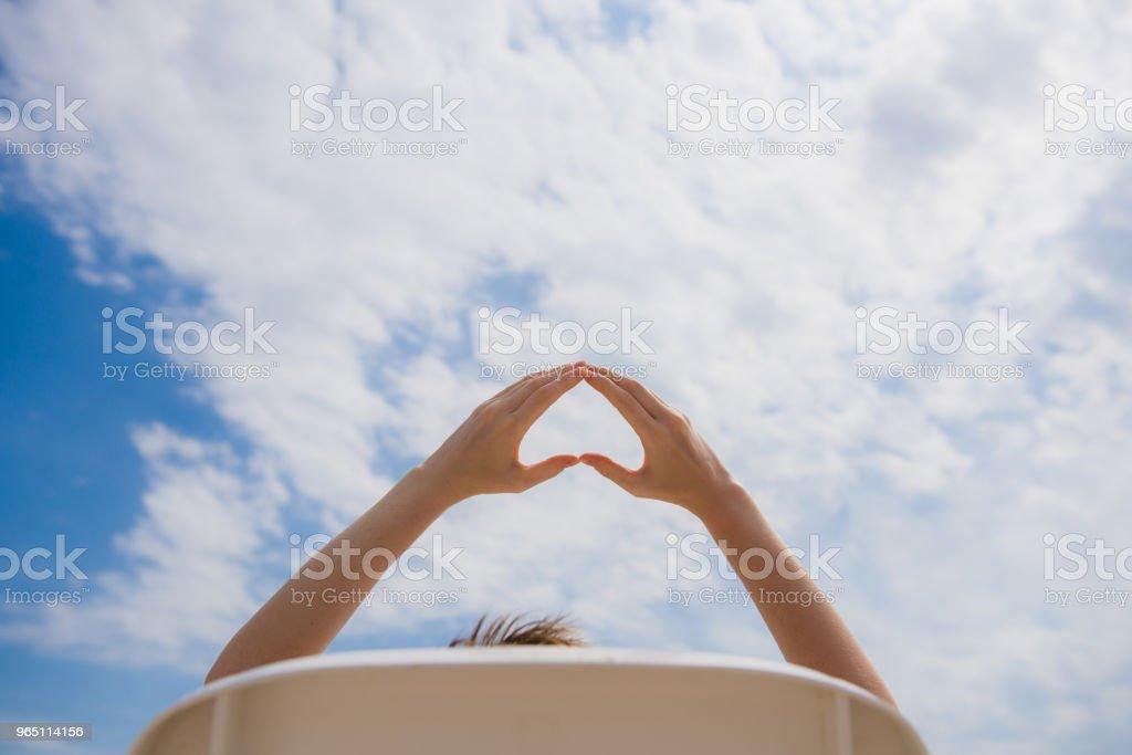 Female hands make heart form outdoors zbiór zdjęć royalty-free