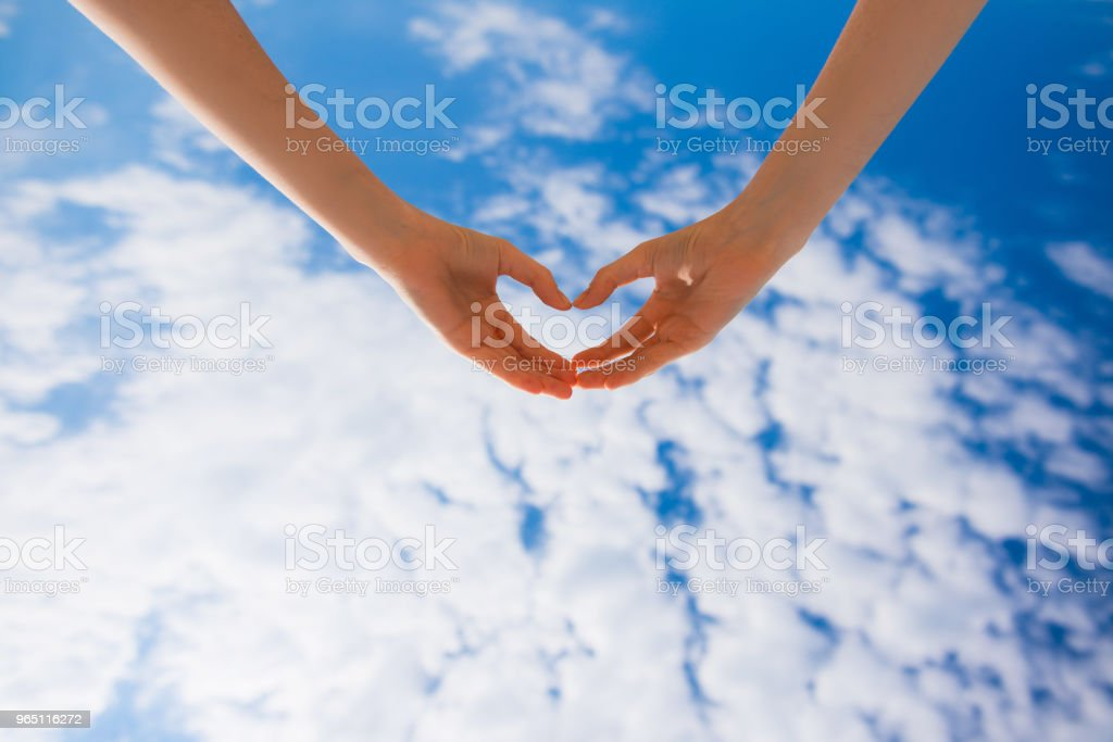 Female hands making heart form royalty-free stock photo