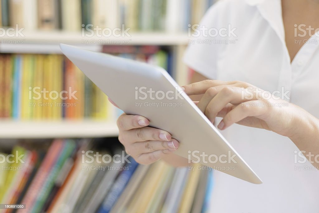 Female hands, making use of tablet computer stock photo