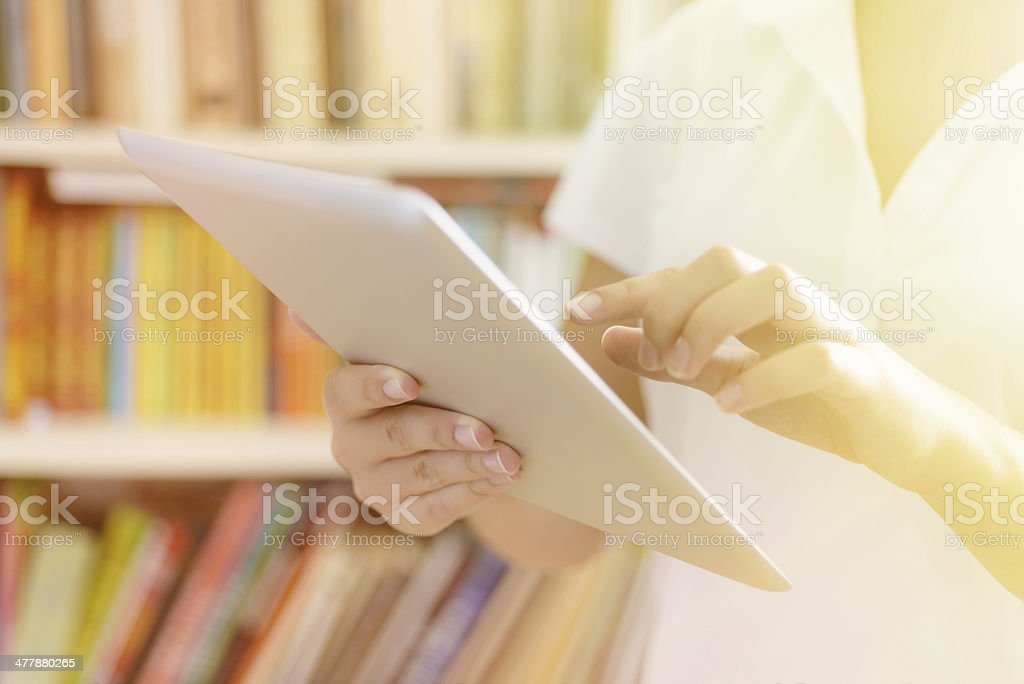 Female hands, making use of tablet computer royalty-free stock photo