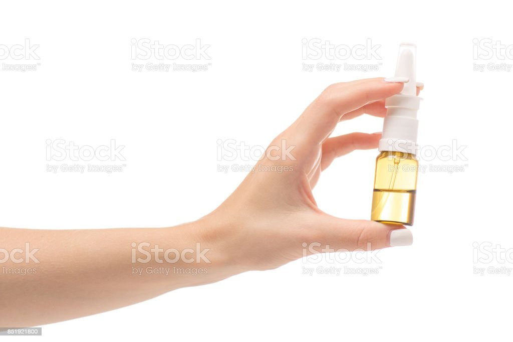 Female hands medicine nose spray stock photo