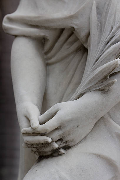 female hands of a statue stock photo