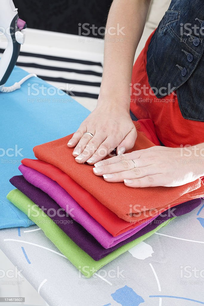 Female Hands On Folded Clothes royalty-free stock photo