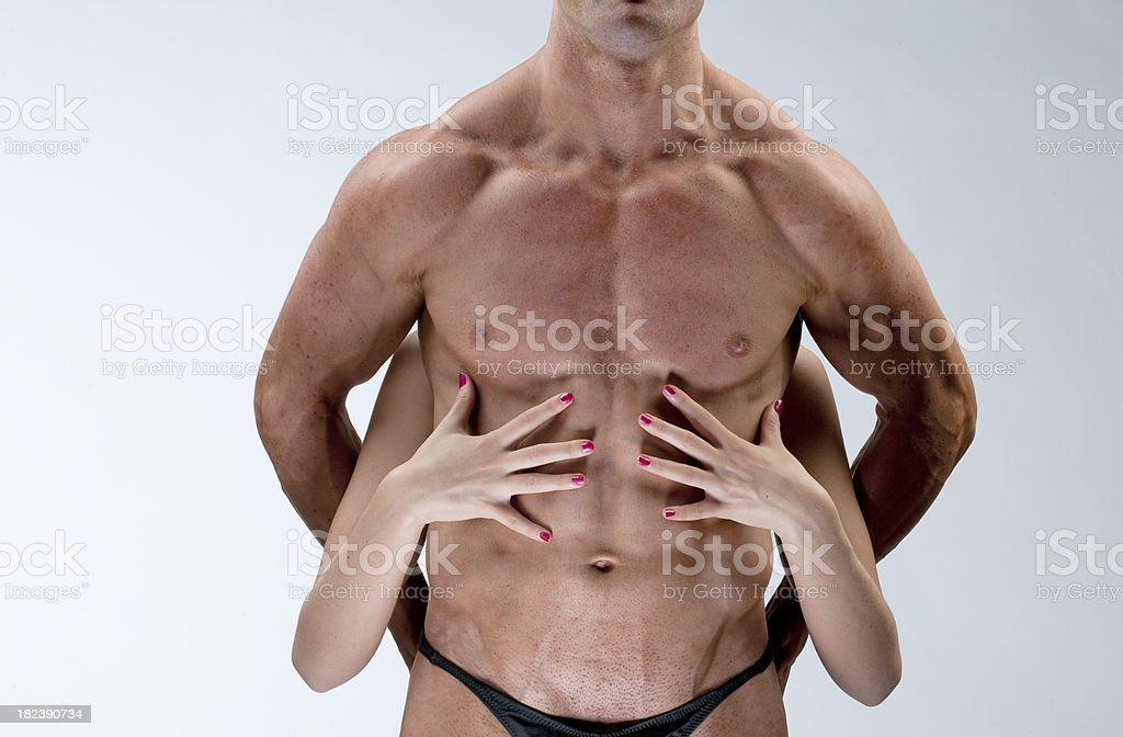 female hands on nude male muscular torso XXXL royalty-free stock photo