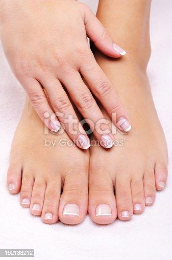 istock female hands on the well-groomed feet 152138212