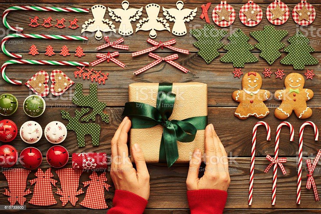 Female hands over christmas gift stock photo