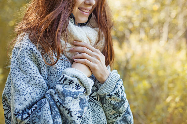 female hands over the sweater (soft focus) stock photo