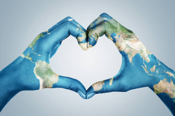 Female hands, painted in the world map,  forming heart shape. Element of this image furnished by NASA ( https://earthobservatory.nasa.gov/blogs/elegantfigures/2011/10/06/crafting-the-blue-marble/ ) stock photo