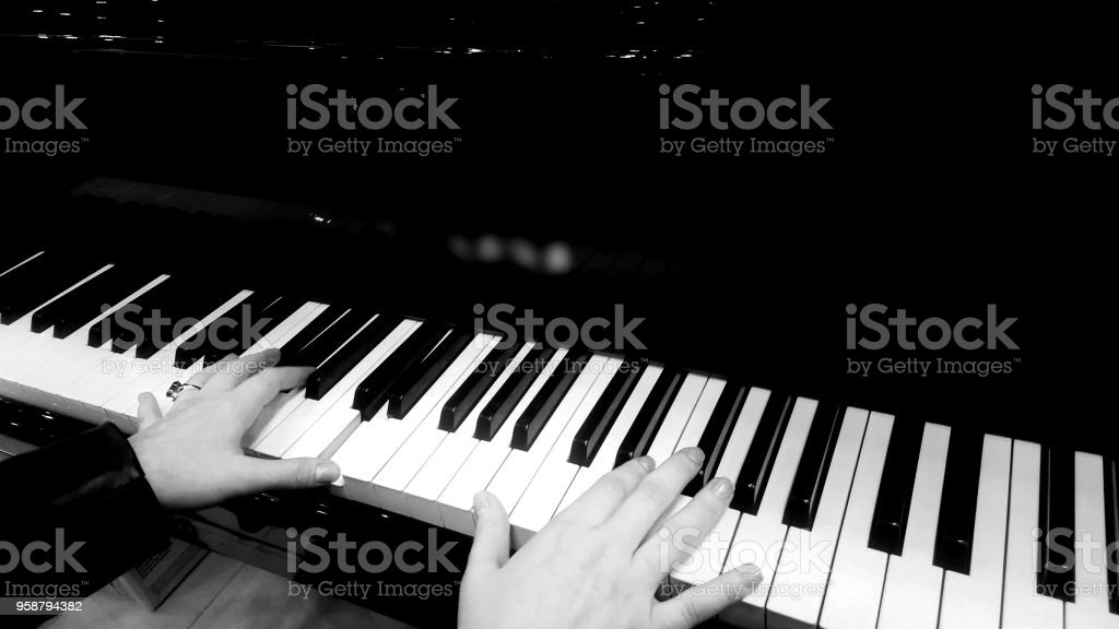 Female hands playing piano, concert of classical music, black and...