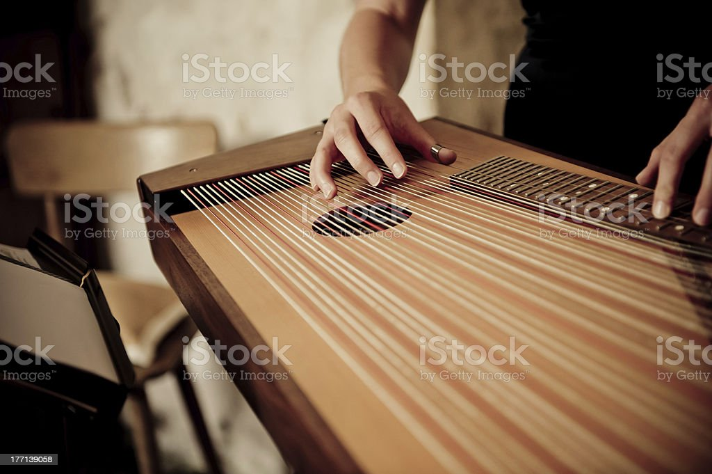 Female hands playing zither stock photo
