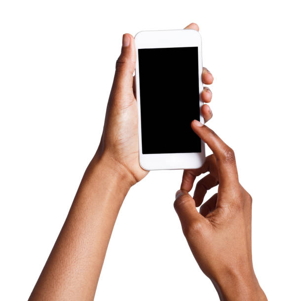 Female hands pointing on blank mobile phone screen Black female hand touching mobile phone display and pointing with index finger on blank screen, white isolated background, copy space, cutout phone stock pictures, royalty-free photos & images