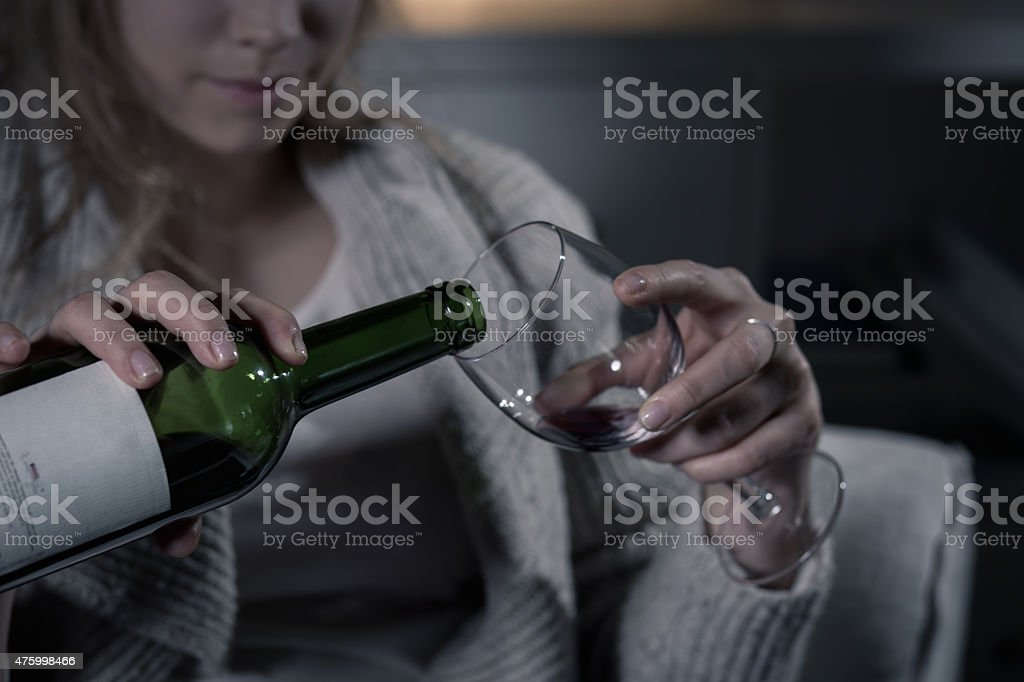 Female hands pouring red wine stock photo