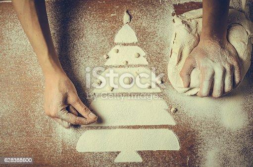 Foto de Female Hands Pressing Dough And Make The Christmas Cookies e mais fotos de stock de Acima