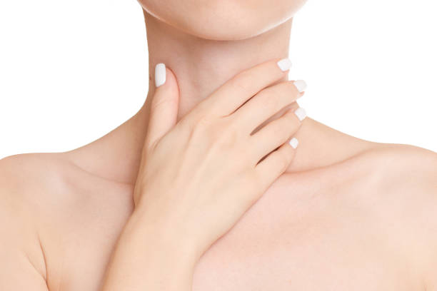 Female hands sore throat stock photo