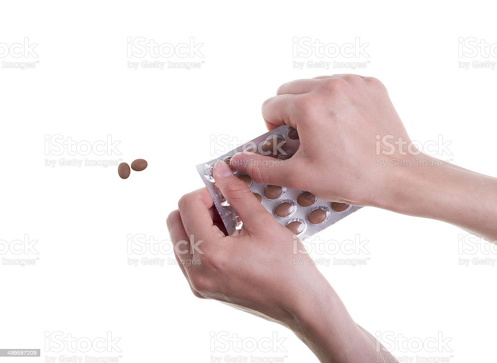 Female Hands Taking Medicine Pills out of a Blister Pack stock photo