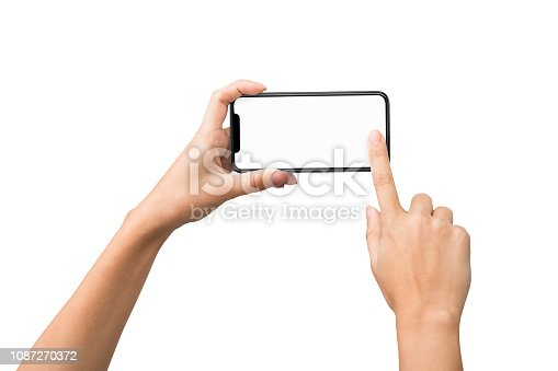istock Female hands taking photo on smartphone with blank screen 1087270372