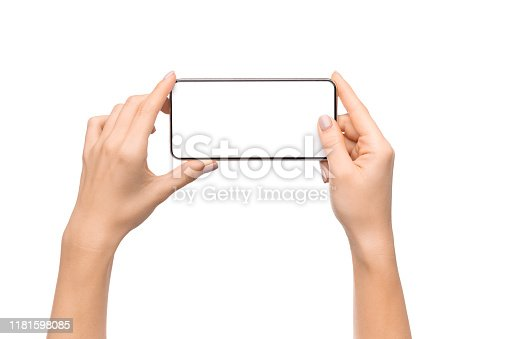 Female hands holding smartphone with blank screen taking photo, isolated on white background, free space