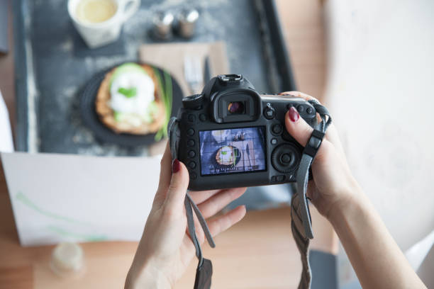 Female hands taking picture of breakfast table set up stock photo